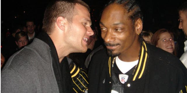 Tom Brady and Snoop Dogg (Photo by Lori Levine/Getty Images)