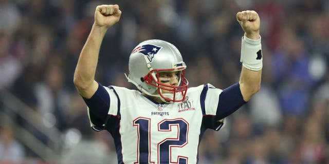 New England Patriots QB Tom Brady #12 celebrates a touchdown against the Atlanta Falcons at Super Bowl 51 on Sunday, February 5, 2017 in Houston, TX. (AP Photo/Gregory Payan)