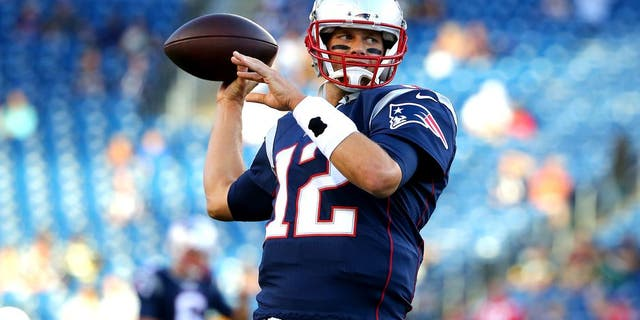 FOXBORO, MA - AUGUST 13: Tom Brady #12 of the New England Patriots warms up prior to a preseason game against the Green Bay Packers at Gillette Stadium on August 13, 2015 in Foxboro, Massachusetts. (Photo by Maddie Meyer/Getty Images)
