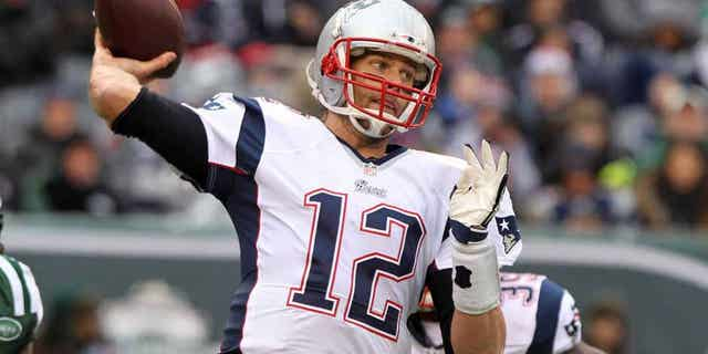 EAST RUTHERFORD, NJ - DECEMBER 21: Tom Brady #12 of the New England Patriots looks to pass during the first half against the New York Jets at MetLife Stadium on December 21, 2014 in East Rutherford, New Jersey. (Photo by Jerome Davis/Getty Images)