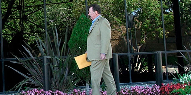 Tom Colbert walking into FBI Ventura County Office Friday with potential new evidence in the D.B. Cooper case,