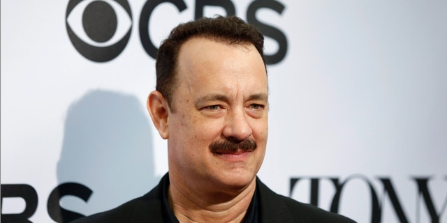 Actor Tom Hanks, nominated for a Tony Award for his acting in the play Lucky Guy, arrives for the 2013 Tony Awards Meet The Nominees Press Reception in New York, May 1, 2013.