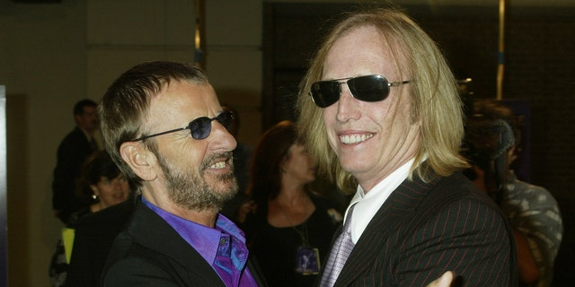 "Musician Ringo Starr, former member of ""The Beatles"" (L) greets musician Tom Petty as he arrives for a screening of ""Concert for George"", a new documentary film celebrating the music of George Harrison through performances by legendary musicians McCartney, Ringo Starr, Billy Preston and Tom Petty and the Heartbreakers, at Warner Bros. studios in Burbank, California September 24, 2003."