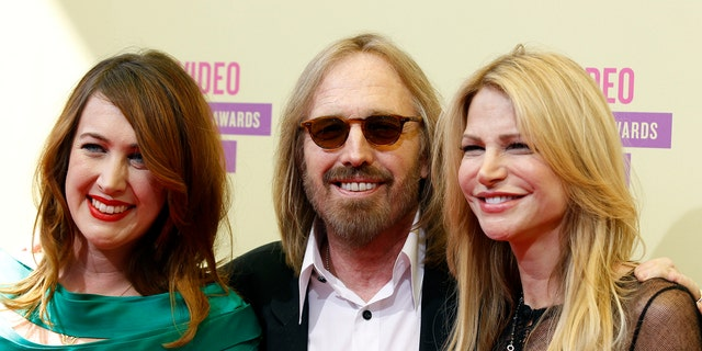 Tom Petty (C), wife wife Dana York (R) and daughter director Adria Petty arrive for the 2012 MTV Video Music Awards in Los Angeles, September 6, 2012.
