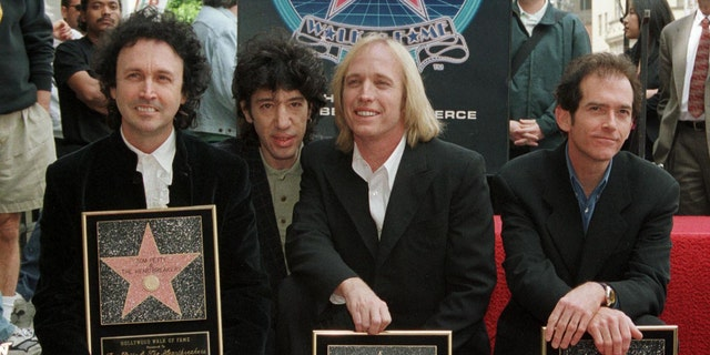 Veteran rockers Tom Petty and the Heartbreakers are shown at the Walk of Fame ceremony in Hollywood April 28, 1999. From l-r: Mike Campbell, Howie Epstein, Tom Petty and Benont Tench.