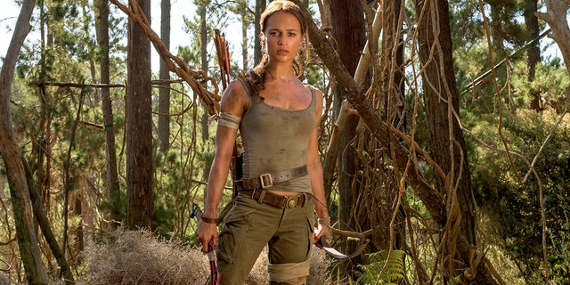"This image released by Warner Bros. Pictures shows Alicia Vikander in a scene from ""Tomb Raider."" It took weeks of training and plates full of protein to turn former ballerina Alicia Vikander into action star Lara Croft. (Graham Bartholomew/Warner Bros. Pictures via AP)"