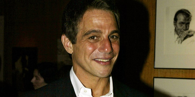 """Actor Tony Danza poses for photographs before the Academy of MotionPicture Arts and Sciences' Centennial Tribute to Richard Rodgers in LosAngeles, California on June 20, 2002. Rodgers is one of America's mostsuccessful composers of show music. Danza was scheduled to perform """"ICould Write a Book,"""" during the tribute. REUTERS/Adrees LatifAL - RTR6NL7"""
