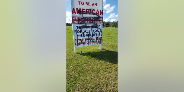 Simmons' sign was vandalized with a vulgar quote by President Trump after she posted about it on Facebook.