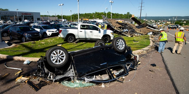 A Nissan sedan on the lot at Ken Pollock Nissan dealership in Wilkes-Barre Twp., Pa. is destroyed on Thursday, June 14, 2018 after a strong storm moved through the area on Wednesday night.