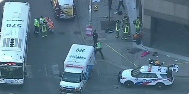 Photos from the scene in Toronto showed bodies in the ground.