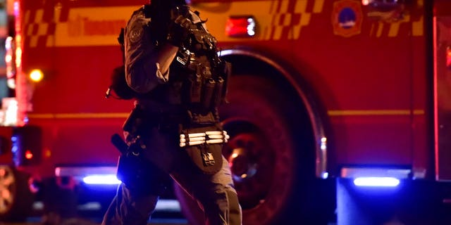 A tactical officer works the scene of a shooting, Sunday, July 22, 2018, in Toronto. (Frank Gunn/The Canadian Press via AP)