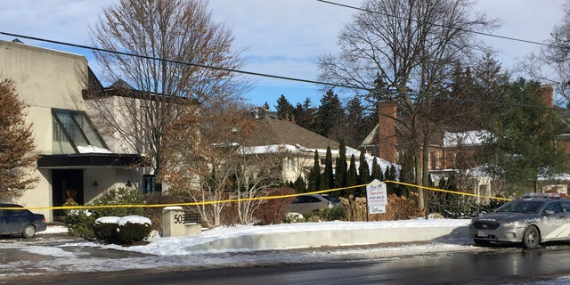 Police tape surrounds the home of billionaire Barry Sherman on Saturday, Dec. 17 2017, in Toronto.