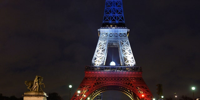 PARIS, FRANCE - NOVEMBER 20:  The Eiffel Tower is illuminated in Red, White and Blue in honour of the victims of Friday's terrorist attacks on November 20, 2015 in Paris, France. Following the terrorist attacks in Paris last week, which claimed 130 lives and injured hundreds more, people continue to mark their solidariity for the victims.  (Photo by Pascal Le Segretain/Getty Images)