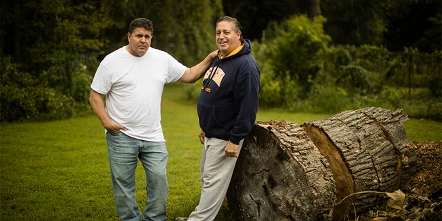 Anthony Torres, right, poses for a photograph with his brother Tom Torres, in Atco, New Jersey on Monday.