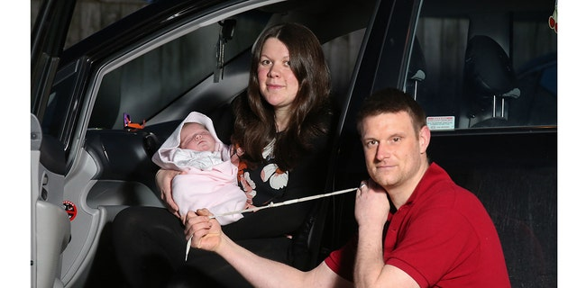 Sarah Galey felt her newborn baby's head coming out on the way to the hospital and dad Jamie Galey had to deliver their daughter in the front seat of the car.