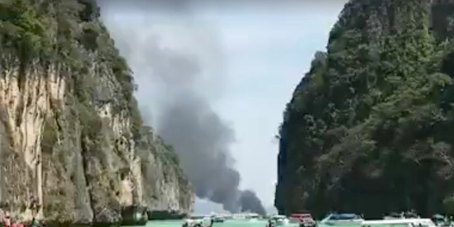 Smoke rises from a tourist speedboat after its explosion in Phi Phi Islands, Thailand, January 14, 2018 in this still image taken from a video obtained from social media.
