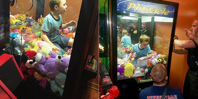 Officials rescued a boy from inside an arcade claw machine on Wednesday in Florida after he climbed inside to get a toy.