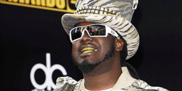 Rapper T-Pain's security guard was detained at the Atlanta airport after trying to go through security with a gun.