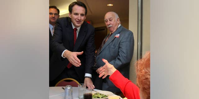 Minnesota Gov. Tim Pawlenty reaches to shake hands with Mary Smyk during a campaign luncheon for Republican congressional candidate Frank Guinta, back left, in Manchester, N.H., Thursday, Sept. 30,2010. Pawlenty is packing in three fund raisers for Republican candidates in New Hampshire. (AP Photo/Jim Cole)