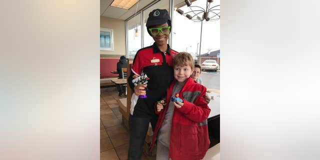 Leif poses with his Teen Titans toy and TQ, who made sure he got it.