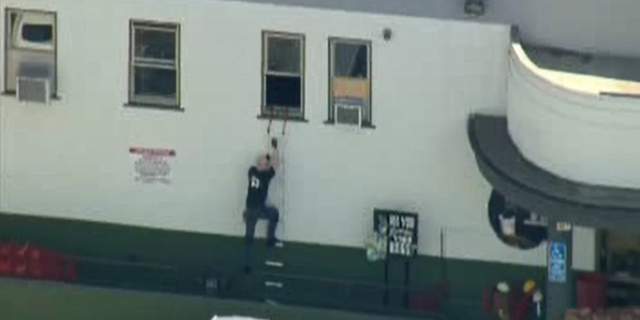 Sean Gerace seen on video climbing down the ladder to help others get to safety.