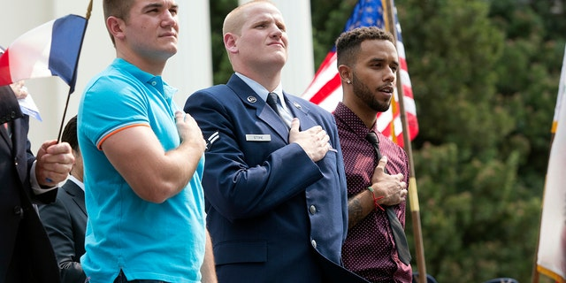 In this Sept. 11, 2015 file photo, Oregon National Guardsman Alek Skarlatos, left, U.S. Airman Spencer Stone, center, and Anthony Sadler attend a parade held to honor the three Americans who stopped a gunman on a Paris-bound passenger train, in Sacramento, Calif.
