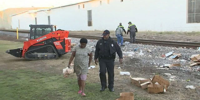 The authorities allowed people to collect the food for about an hour before they had to clear the site.