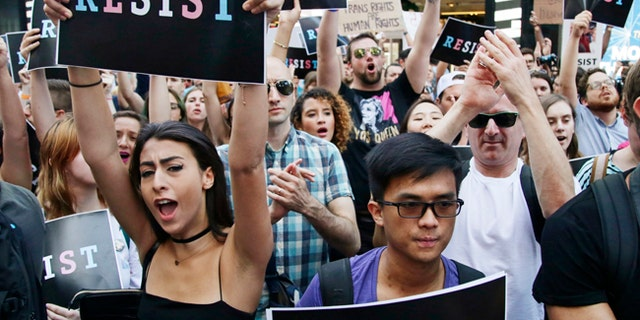 Protesters attend a New York City rally against President Trump's ban on transgender people serving in the U.S. military.