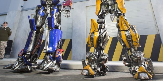 Optimus Prime, leader of the Autobots, and Bumblebee are now making in-park appearances at Universal Studios Florida.  Towering at more than nine-feet-tall, the characters will be in-park daily to meet, interact and take larger-than-life photos with guests. Universal Orlando Resort introduced this experience to get guests ready for the battle they'll experience when TRANSFORMERS: The Ride – 3D opens this summer.  © 2013 Universal Orlando Resort. All rights reserved.