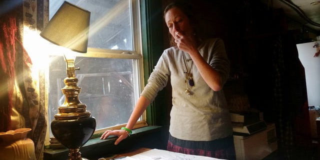 Michelle Knowles stands in her home Wednesday, Nov. 16, 2016, in North Vassalboro, Maine. Knowles is calling for more mental resources at juvenile detention facilities following her son Charles' suicide. Charles, a 16-year-old transgender boy who dreamed of being an LGBT activist, killed himself while temporarily detained at Long Creek Youth Development Center on Nov. 1, in South Portland, Maine. Family members say he was denied mental health care. (AP Photo/Marina Villeneuve)