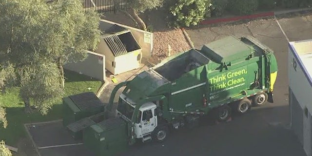 A truck driver told FOX10 he'd seen the man and woman living in the dumpster for six months.