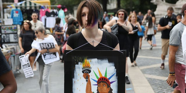 An activist in New York City displays a placard during a protest against the U.S. Supreme Court's decision.