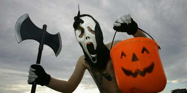 SYDNEY, AUSTRALIA - OCTOBER 31:  A young boy poses in costume before trick or treating on Halloween Day in North Bondi on October 31, 2008 in Sydney, Australia. Halloween, also known as Hallowe'en and shortened from its original form of All Hallows' Even, is internationally celebrated on October 31 and originates from the ancient Celtic festival of Samhain, which was a celebration recognising the end of the harvest in Gaelic culture.  (Photo by Sergio Dionisio/Getty Images)