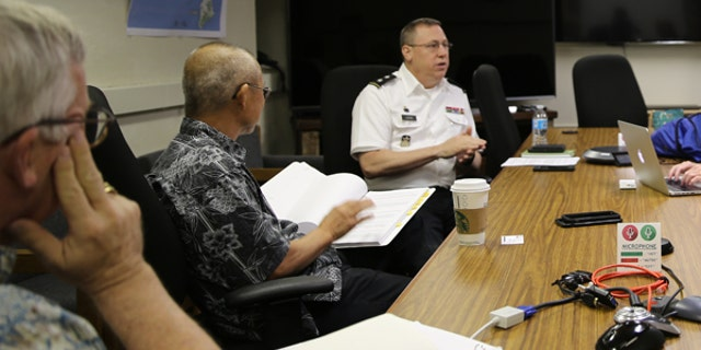 """Major Gen. Arthur """"Joe"""" Logan (center), Hawaii's adjutant general, director of the Hawaii Emergency Management Agency and director of the Office of Homeland Security, meets with emergency planning team members."""