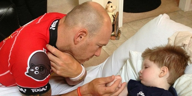 Cyclist Dave Nazaroff, founder of nonprofit RIDE to GIVE, visits Tripp Halstead in a hospital in Georgia.