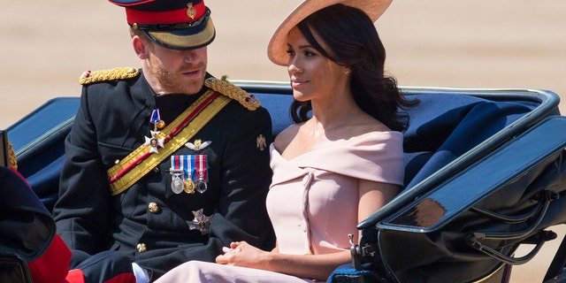 The Duke and Duchess of Sussex ride in the Trooping of the Coulors military parade before heading into Buckingham Palace.