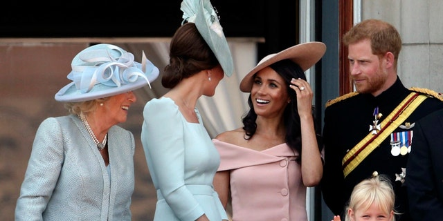 From left, Camilla Duchess of Cornwall,Kate Duchess of Cambridge, Meghan Duchess of Sussex and Prince Harry, on the balcony of Buckingham Palace, in central London, following the Trooping the Colour ceremony.