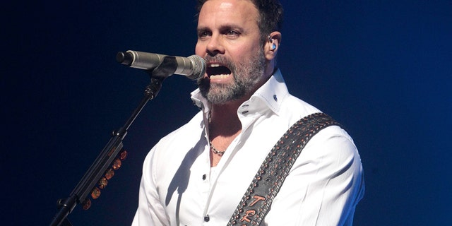 In this Jan. 17, 2013 file photo, Troy Gentry of the Country Music duo Montgomery Gentry performs on the Rebels On The Run Tour in Lancaster, Pa.