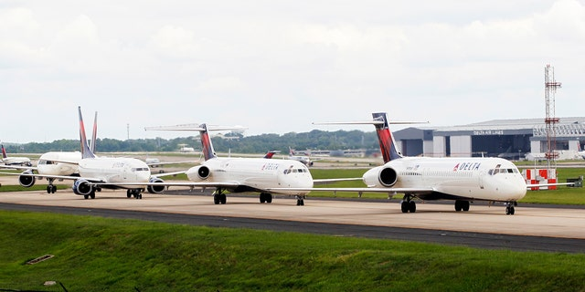 Delta airplanes line up on the taxi way at Hartsfield Jackson Atlanta International Airport.