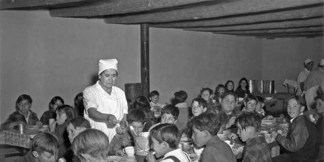 The hot lunch, school at Penasco. Childred pay about once cent daily for this hot meal made up primarily of food from the surpus commodities program, and prepared by WPA paid cooks December 1941 in Taos Co, NM.