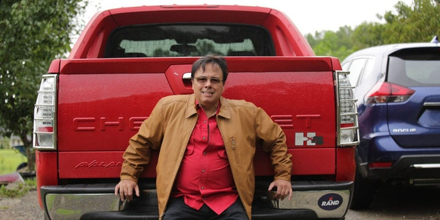Gerardo Serrano with his new, leased truck. He is still making monthly payments of $673 on the seized truck as well as paying for its insurance and Kentucky license fees.