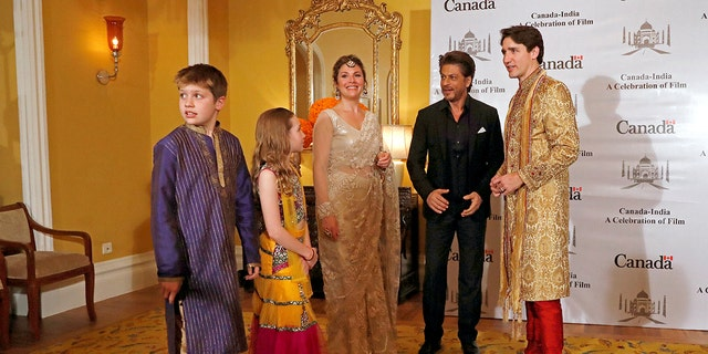 Trudeau, his wife Sophie Gregoire Trudeau, their daughter Ella Grace and son Xavier pose with Bollywood actor Shah Rukh Khan in Mumbai.