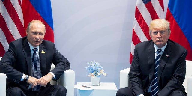 Putin and Trump meet in 2017 during the G-20 gathering