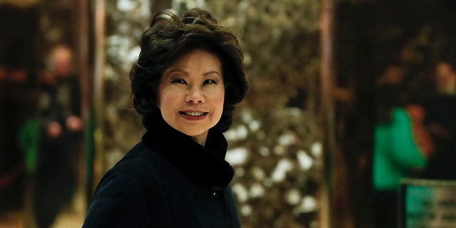 FILE - In this Nov. 21, 2016 file photo, Transportation Secretary-designate Elaine Chao arrives at Trump Tower in New York. Propelled by populist energy, President-elect Donald Trump's candidacy broke long-standing conventions and his incoming Cabinet embodies a sharp turn from the outgoing Obama administration. (AP Photo/Carolyn Kaster, File)