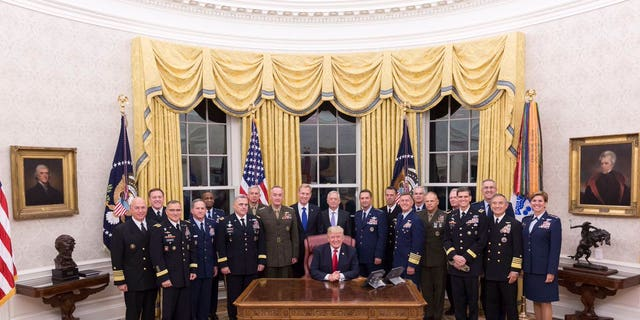 President Donald Trump welcomes Pentagon officials to the Oval Office, Oct. 5, 2017.