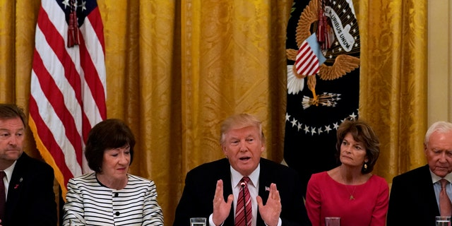 U.S. President Donald Trump meets with Senate Republicans about healthcare in the East Room of the White House in Washington, U.S., June 27, 2017. Trump is flanked by Senators Susan Collins (R-ME) and Sen. Lisa Murkowski (R-AK). REUTERS/Kevin Lamarque     TPX IMAGES OF THE DAY - RTS18VV0