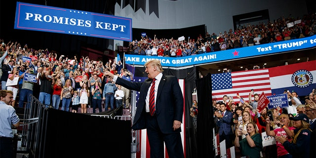 President Donald Trump arrives to speak during a campaign rally on Friday in Springfield, Mo.