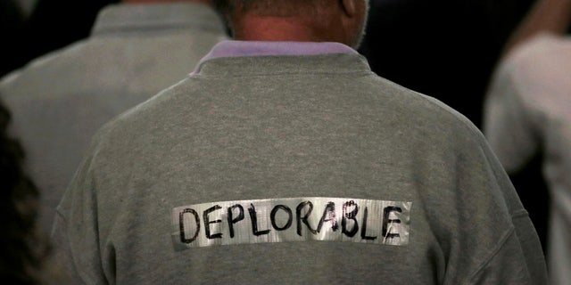"""A supporter of President-elect Donald Trump wears tape with the word """"deplorable"""" written on it in the audience at a campaign rally in Laconia, New Hampshire, U.S., September 15, 2016."""