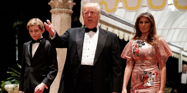 President Donald Trump, first lady Melania Trump and their son Barron arrive for a New Year's Eve party at Mar-a-Lago in Florida, Dec. 31, 2017.