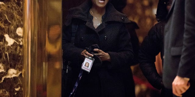 """In this Jan. 2, 2017, photo, Omarosa Manigault arrives at Trump Tower, in New York. A memorable contestant in the first season of """"The Apprentice,"""" Manigault is expected to join President-elect Donald Trump's White House staff, according to two people familiar with the decision. Her job is expected to focus on public engagement. (AP Photo/Andrew Harnik)"""